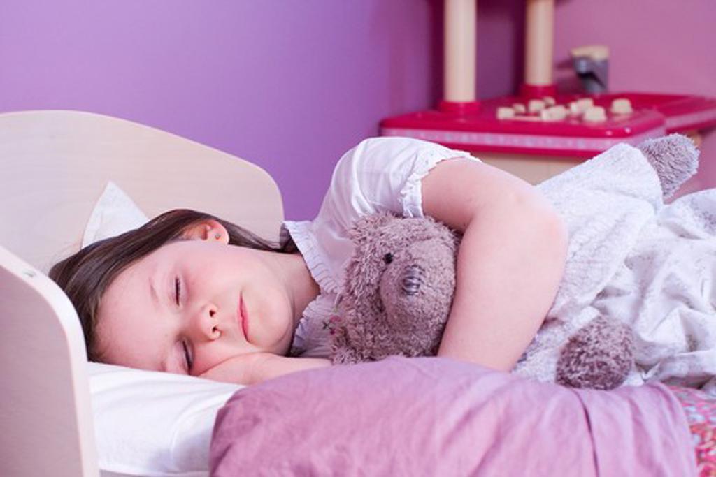 Stock Photo: 4252-1988 Little girl sleep stuffed animal