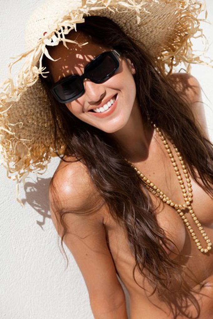 Woman hat suntanning : Stock Photo