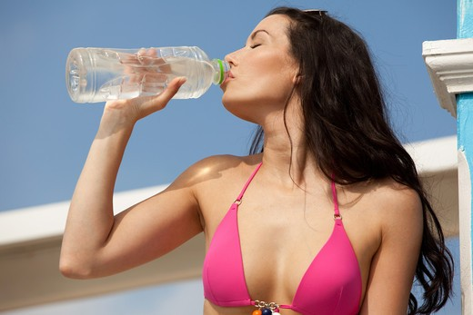 Stock Photo: 4252-22328 Woman beach water