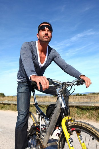 Stock Photo: 4252-22646 Man bike