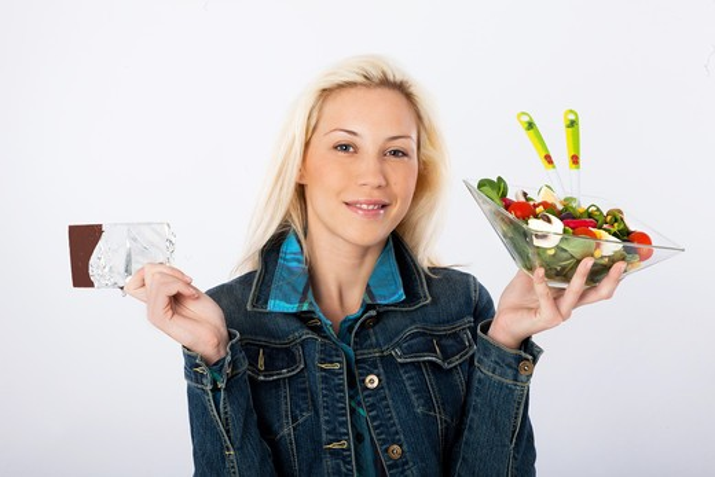 Woman choice chocolate salad : Stock Photo