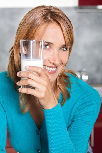 Stock Photo: 4252-24193 Woman milk glass