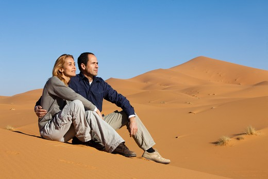 Stock Photo: 4252-24448 Couple Morocco desert