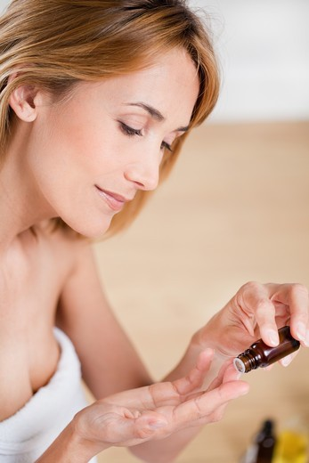 Stock Photo: 4252-24700 Woman essential oil