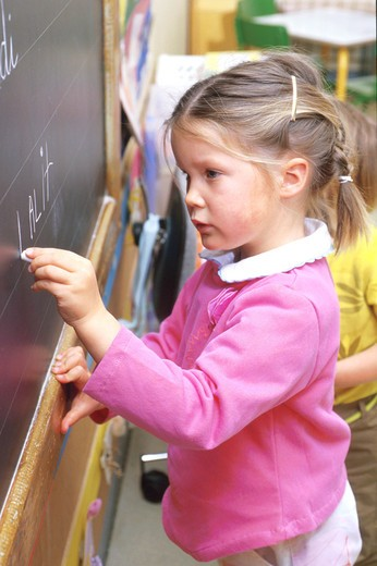 children inside girl school writing expression blackboard class thinking : Stock Photo