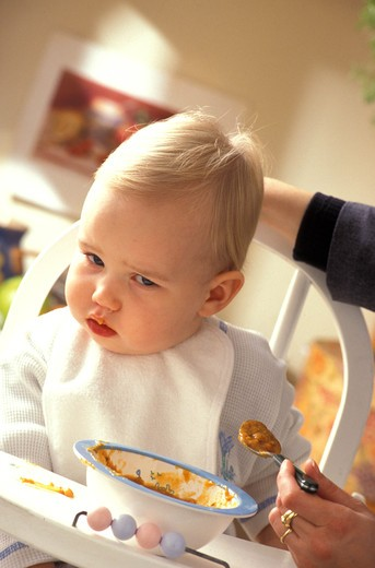 Stock Photo: 4252-25284 family inside woman baby child food chair spoon soup sulking mother