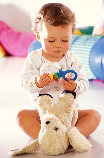 children inside boy play baby toy sitting soft toy : Stock Photo