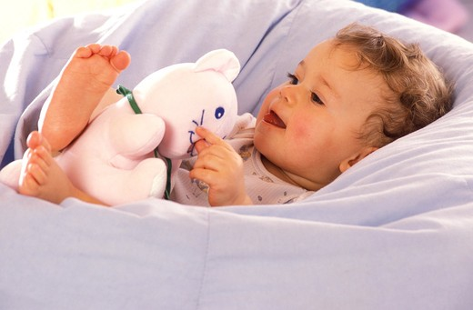 Stock Photo: 4252-25399 children inside boy play baby lying duvet soft toy smiling