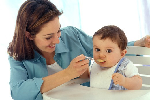 Stock Photo: 4252-25691 Woman baby and meal