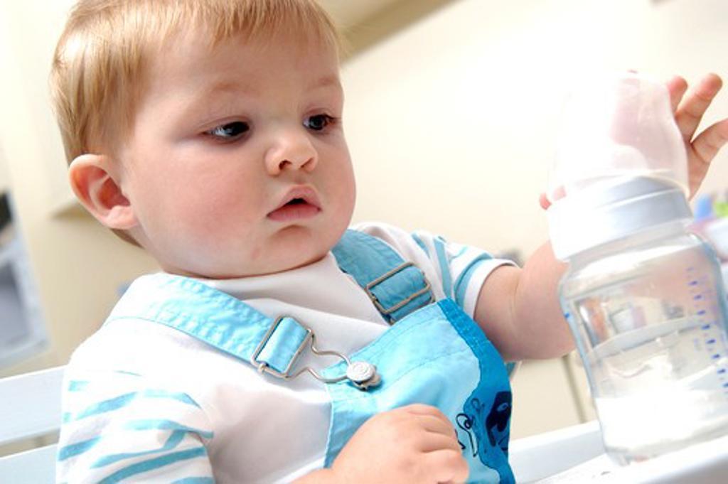 Stock Photo: 4252-26106 Baby boy feeding bottle