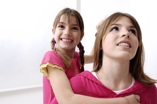 Stock Photo: 4252-27140 Sisters having fun