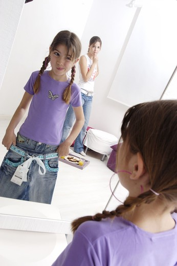 Little girl in front of a mirror : Stock Photo