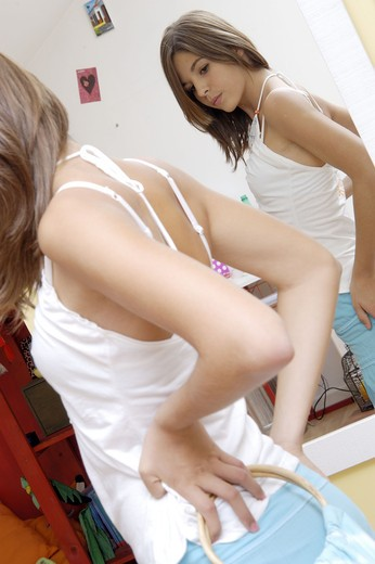 Stock Photo: 4252-27260 Teenager looking into the mirror