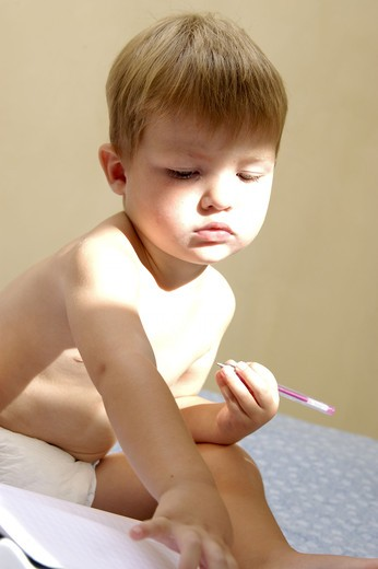 Stock Photo: 4252-27301 Little boy drawing