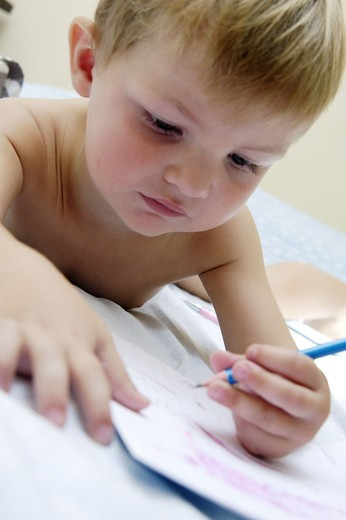 Little boy drawing : Stock Photo