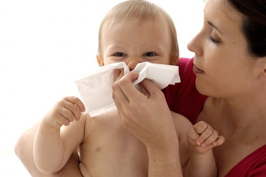 Stock Photo: 4252-27430 Woman blowing baby's nose