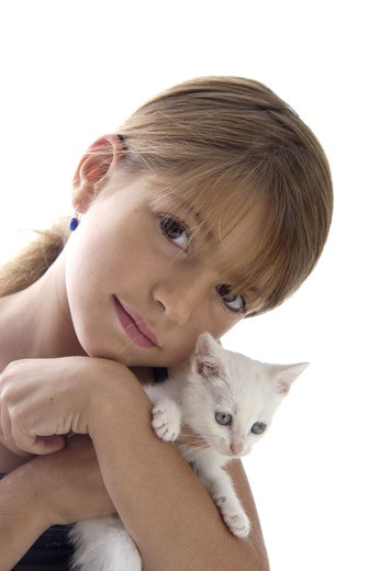 Stock Photo: 4252-27621 Little girl with a cat