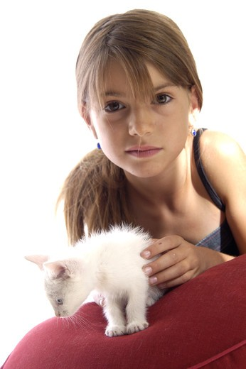 Stock Photo: 4252-27625 Little girl with a cat