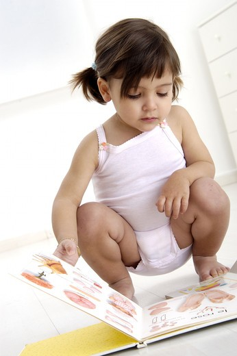 Stock Photo: 4252-28489 Little girl and book