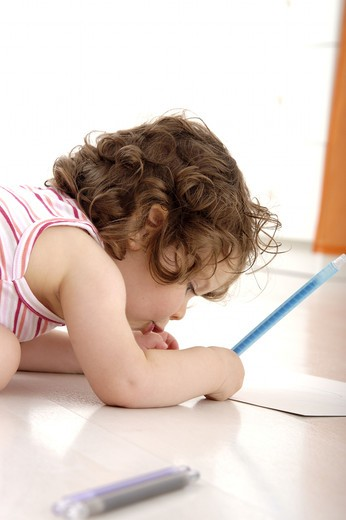 Little girl drawing : Stock Photo