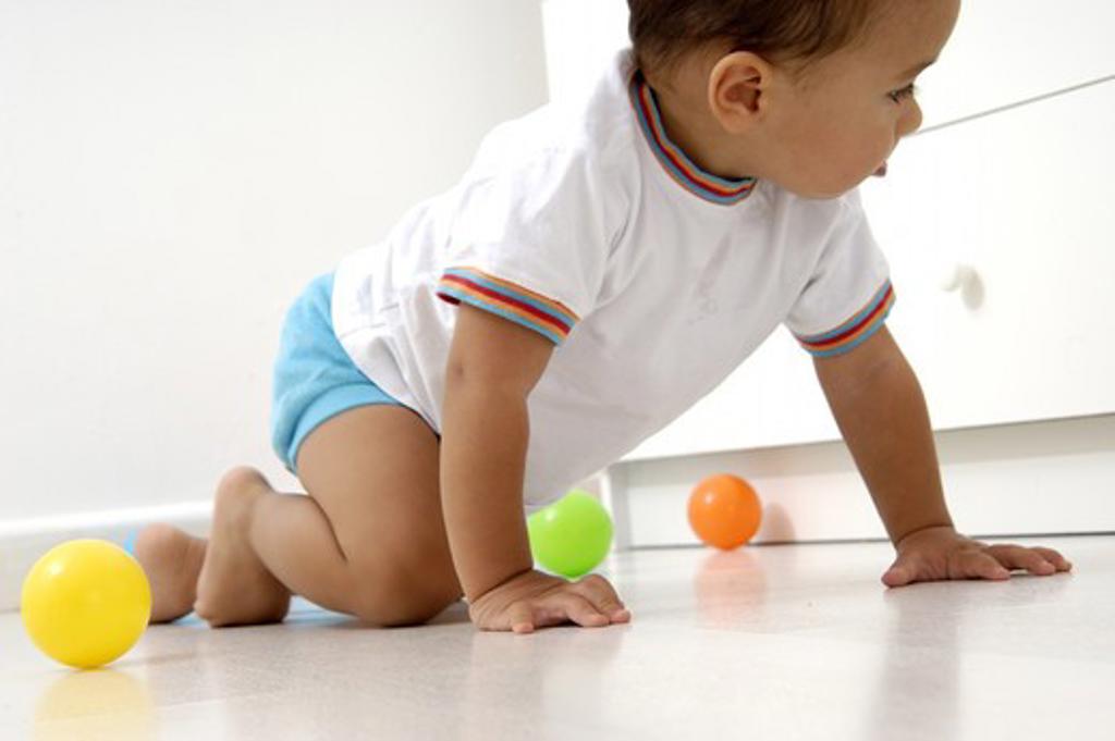Baby crawling. : Stock Photo
