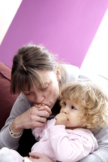 Stock Photo: 4252-29472 Woman child tenderness