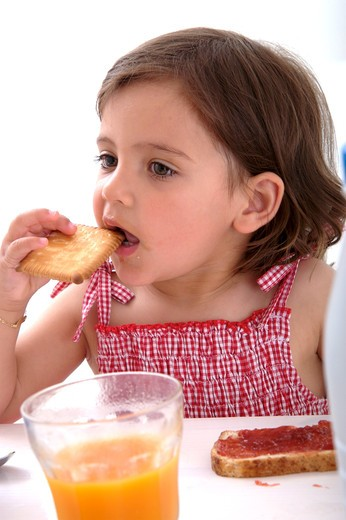 Little girl breakfast : Stock Photo