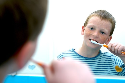 Stock Photo: 4252-29945 Boy toothbrush
