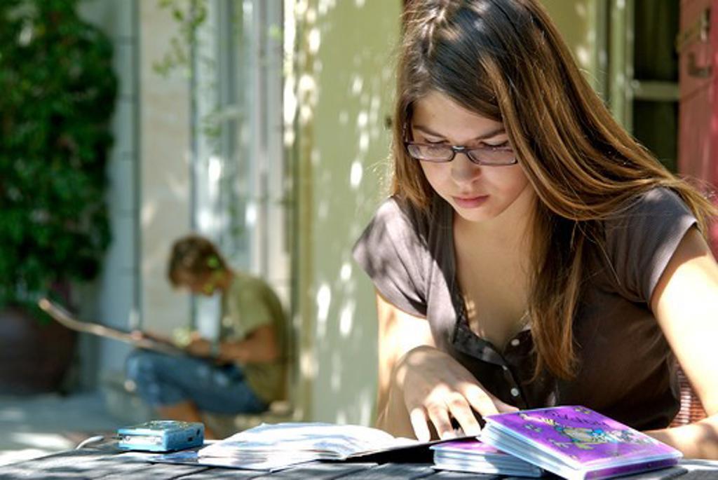 Stock Photo: 4252-30472 Teenage girl studying