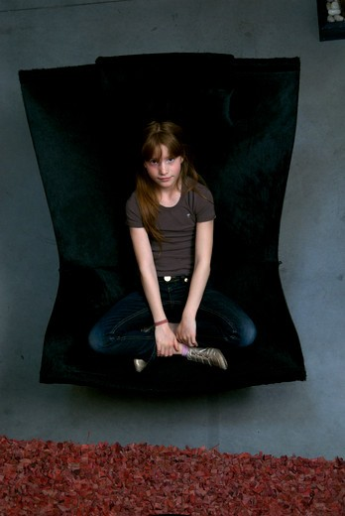 Girl armchair : Stock Photo