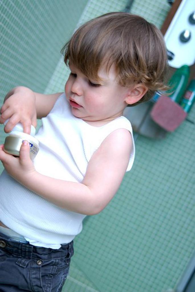 Stock Photo: 4252-30512 Boy playing cream