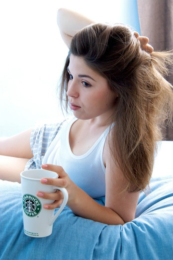 Stock Photo: 4252-30619 Teenage girl coffee mug