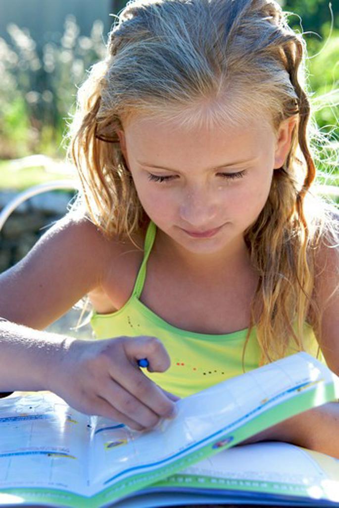 Little girl holiday homework : Stock Photo