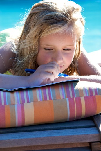 Stock Photo: 4252-30644 LIttle girl holiday homework