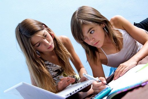 Stock Photo: 4252-30953 Teenagers homeworks.