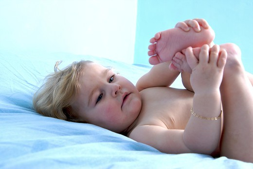 Lying down baby : Stock Photo