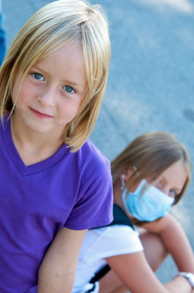 Stock Photo: 4252-32290 Girls swine flu mask