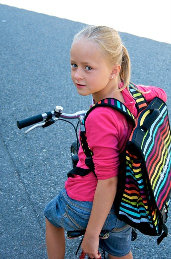 Stock Photo: 4252-32649 Little girl bike school