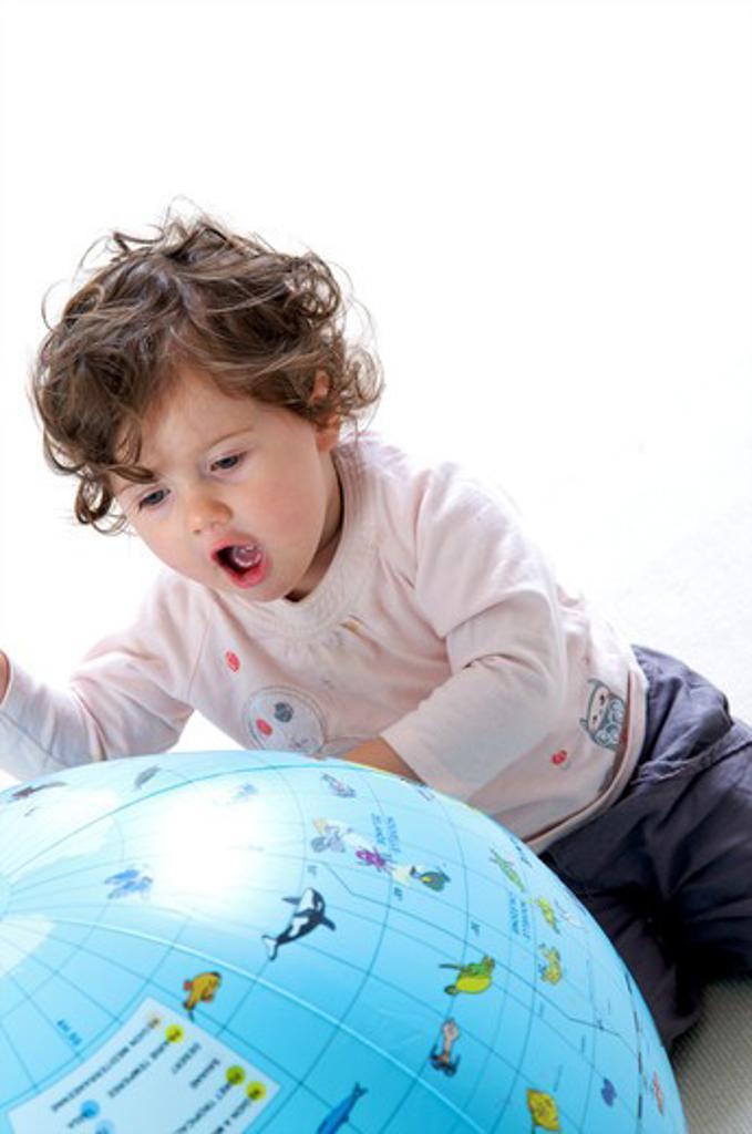 Stock Photo: 4252-32732 Baby globe playing