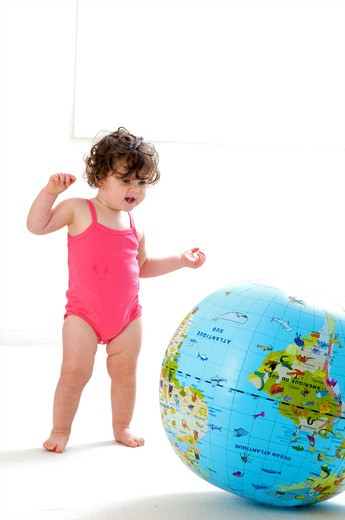 Stock Photo: 4252-32733 Baby globe playing