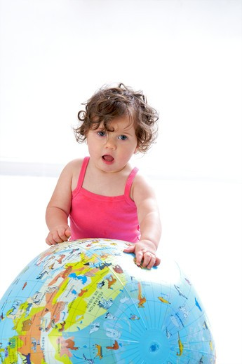 Stock Photo: 4252-32734 Baby globe playing