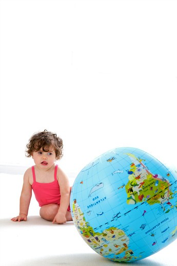 Baby globe playing : Stock Photo
