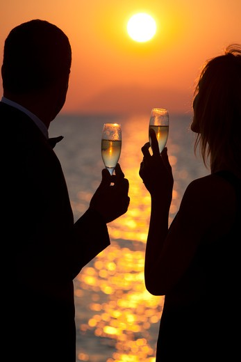 Stock Photo: 4252-32953 Couple champagne sunset