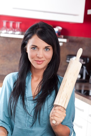 Stock Photo: 4252-33019 Woman rolling pin