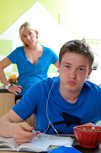 Stock Photo: 4252-33116 Teenage boy homework