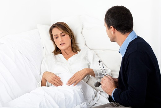 Stock Photo: 4252-33567 Woman stomach pain doctor