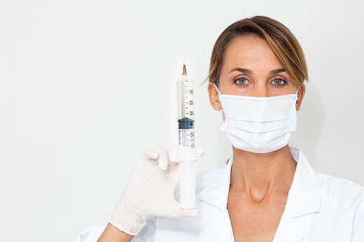 Stock Photo: 4252-33747 Doctor woman syringe