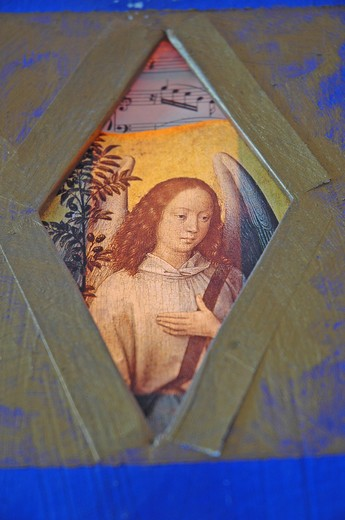 Stock Photo: 4252-35556 FRame religious paint of an angel near an olive tree