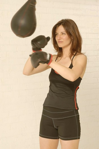 Stock Photo: 4252-363 Woman punching-ball