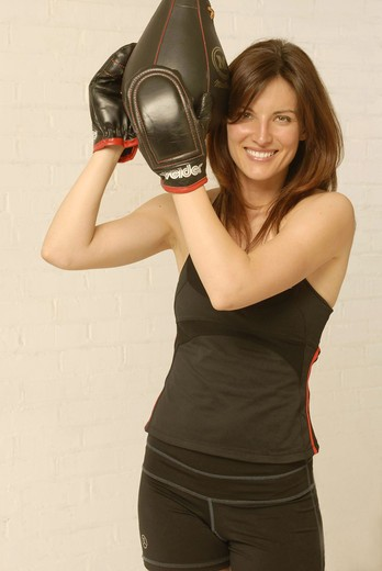 Woman punching-ball : Stock Photo